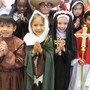 All Saints Catholic School Photo #3 - Our feast day celebration includes many traditions, including our 3rd Grade Saints Procession at Mass, the raising of the Saints banners, Saint Puppet presentations by our second graders, and the Saints Cafe which features our middle school students sharing the lives of the saints in a large assembly and from classroom to classroom.