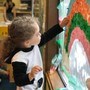 French Immersion School Of Washington Photo #5 - A Pre-School student is decorating the window with colored papers.