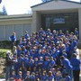 Pacific Union College Elementary School Photo #2 - The whole student body on the front steps on a sunny spring day sporting new T-shirts commemorating one hundred years of educating children in Angwin.