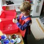 The Happy Childrens Montessori Photo #3 - A boy doing the dishwashing work.