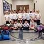 St. John Neumann Academy Photo - Kindergarten Service Project - Coats for Kids