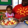 Alexandria KinderCare Photo #4 - The Discovery Preschool class (2s) get to learn through fun cooking projects. Counting the fruit helps teach math for kids.