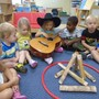 Overland Park KinderCare Photo #7 - Using our imagination - signing around the campfire!