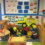 Shelton KinderCare Photo - This is one of the enhancements for our dramatic play area. The children helped the teacher create a construction site during the tools and machines unit. The children used blocks, hammers, screw drivers, levels and so many more tools as they build different buildings, factories and structures. The children were arctitects, construction workers and used their imagination to be whatever they wanted to be! They used their hand-eye coordination, role paying skills, cooperation and problem-solving skills and gained knowledge of concepts such as area, height, weight and length while exploring cause and effect. Exploration is a leading form of learning here at KinderCare. Every activity, enhancement and toy has an educational purpose behind it. We would love to show you what your child will learn here!