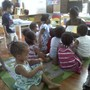 "Nsoroma Academy for Holistic Thought Photo #2 - Our youngest learners enjoy one of their favorites times of the day: ""Akoma Reading Circle!"""
