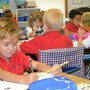 Prince Of Peace Catholic School Photo - Getting busy in 1st Grade!