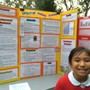 The Hilldale School Photo #2 - A student is ready to answer questions about her Science Fair project.