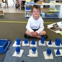 Montessori School At Lone Tree Photo #7 - Geometric Solids, a traditional Montessori activity, where children learn about geometry and to identify some solid figures.