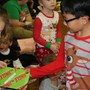 St. Mary Magdalen School Photo #6 - At the annual Student Secret Santa - grades Pre-K through 8 come together to exhange gifts that they made for one another to celebrate the Christmas season.