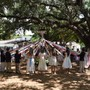 St. Stephen's Episcopal Day School Photo #7 - The Maypole has become a favorite part of the graduation festivities. A tall pole with long pastel-colored ribbons suspended from the top, festooned with flowers to match the flowers worn by the graduates, is erected under the oaks. Encircled by faculty, friends, and family, the graduates perform intricate dances around the Maypole.