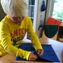 Oak Grove Montessori School Photo #3 - Practical life skills, such as buttoning, develop fine-motor muscles and coordination important for handwriting.