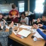 Joliet Montessori School Photo #5 - Adolescents students learning topology with mobius loops and hexaflexagons.