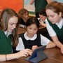 Our Lady Of Perpetual Help Photo - Our 7th grade and 1st grade buddies work on a project together with iPads.
